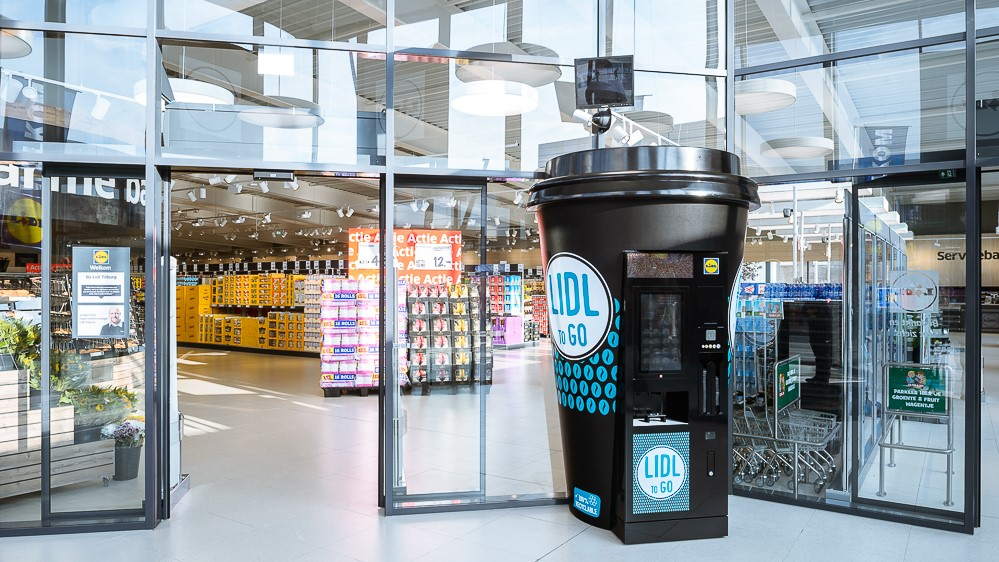 Displays - Koffiebeker display coffee cup instore marketing Publi air