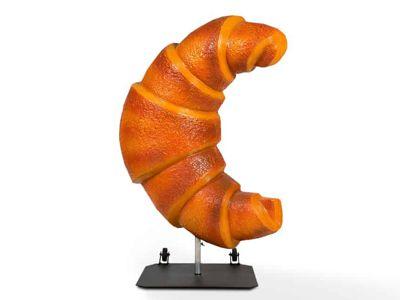 Solid croissant als 3D stoepbord